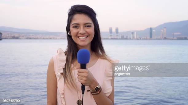 female tv reporter - journalist stock pictures, royalty-free photos & images