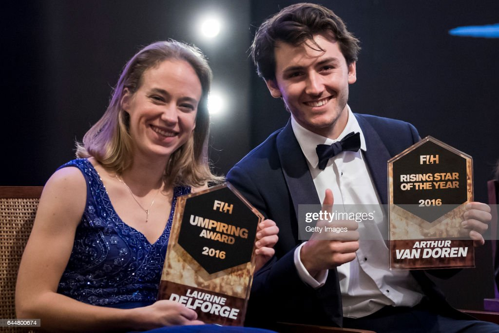 Female Umpiring Award Laurine Delforge of Belgium [L] and FIH Male Rising Star of the Year Arthur Van Doren [R] of Belgium pose for a picture during..