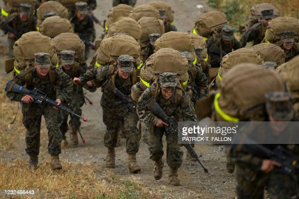 Female United States Marine Corps recruits from Lima Company, the first gender integrated training class in San Diego complete their 9.7 mile hike on...