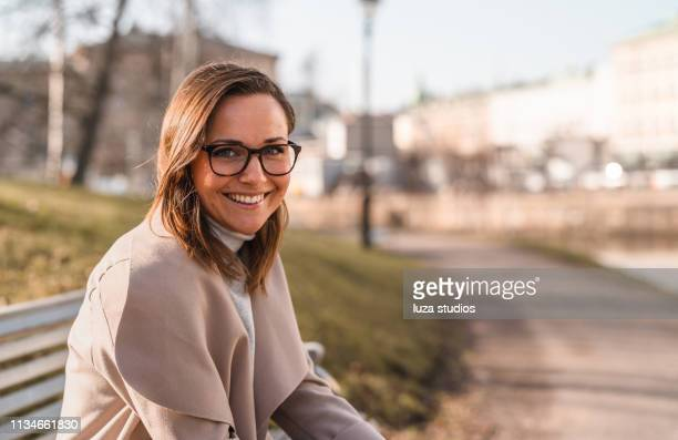 female university student is reading a book in the city - scandinavia stock pictures, royalty-free photos & images