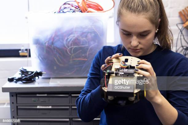 female university student working on her new project at the lab - physics stock pictures, royalty-free photos & images
