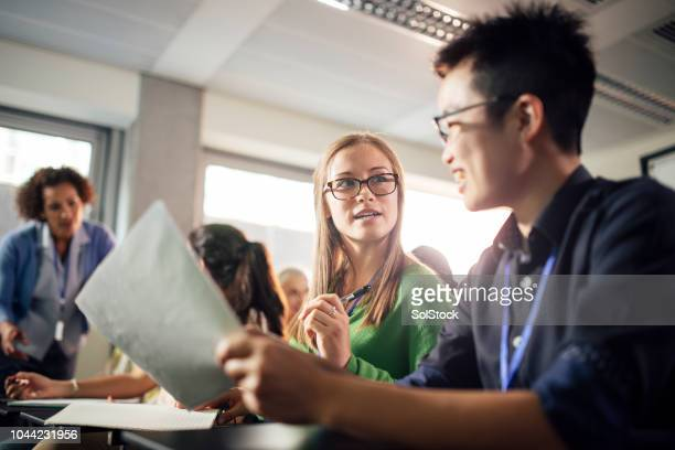 female university students discuss presentation, very real - debate stock pictures, royalty-free photos & images