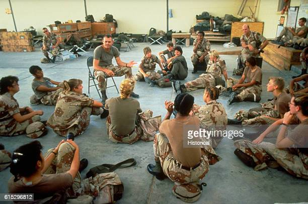 Female US military personnel take part in a discussion in preparation for deployment to Saudi Arabia during Operation Desert Shield