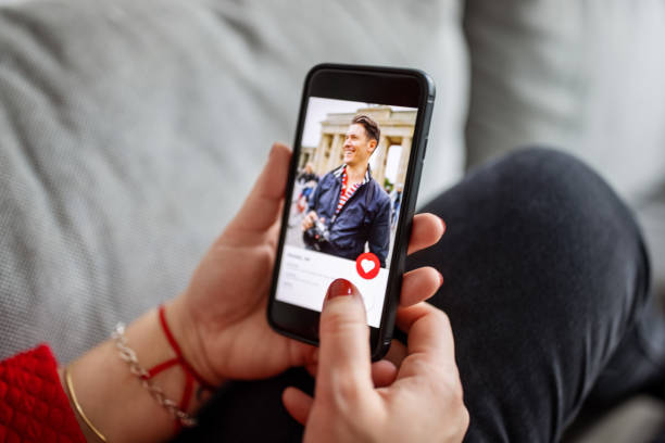 female using a dating app on smart phone - woman dating stock pictures, royalty-free photos & images