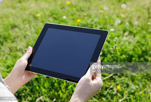 Female using a digital tablet