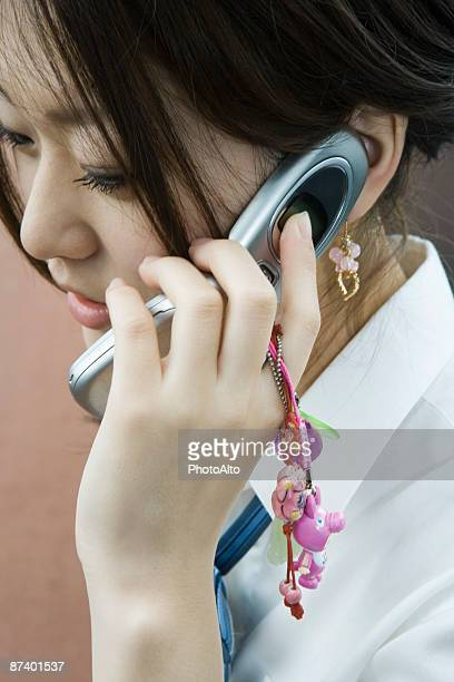 Female using cell phone decorated with charms