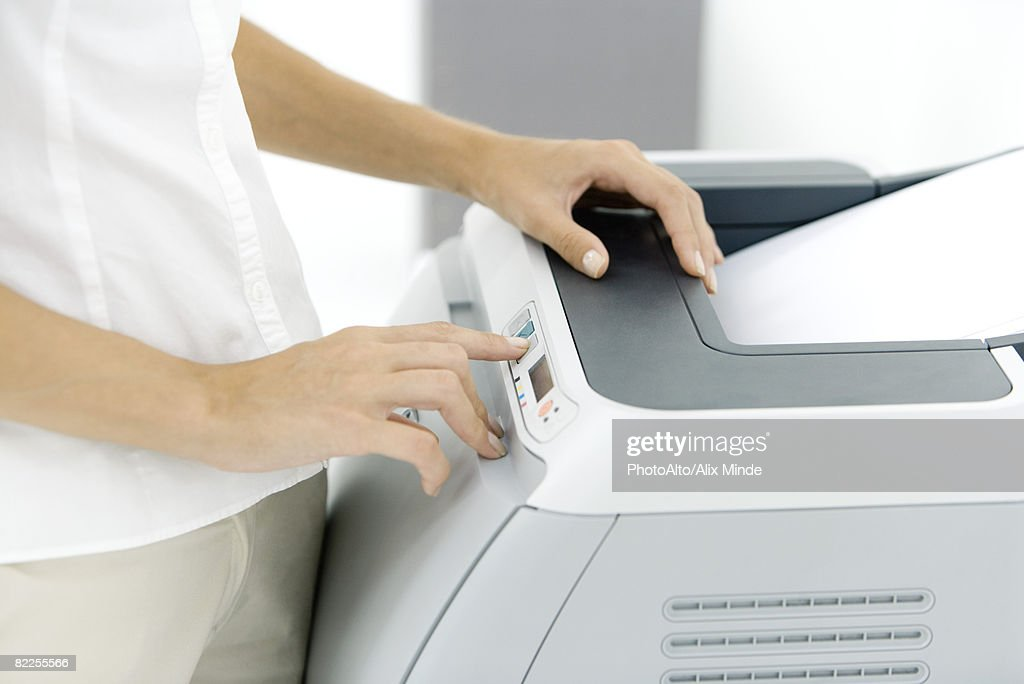 Female using photocopier, cropped view : Stock Photo