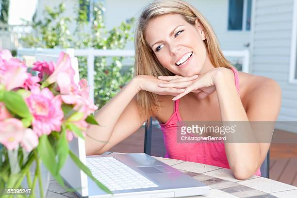 Female using technology outdoors