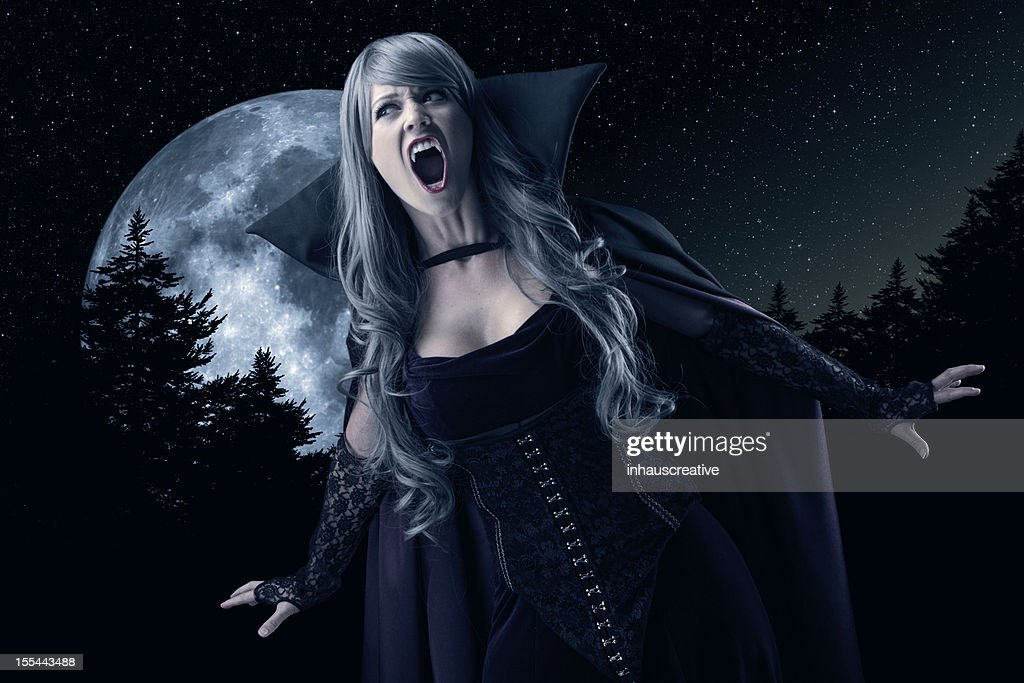 Female Vampire Howling At The Moon High-Res Stock Photo -8684
