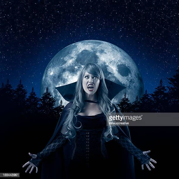 Female Vampire howling at the moon