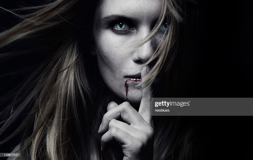 A female vampire with blood dripping : Stock Photo