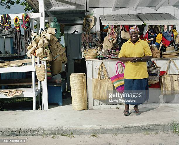 female vendor in front of stand, smiling - market vendor stock pictures, royalty-free photos & images