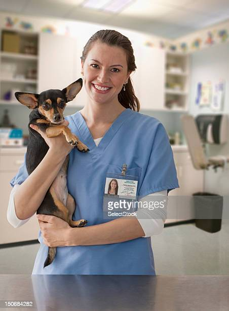 Female veterinarian with small dog