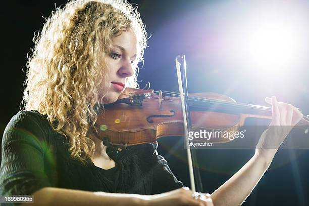 female violinist. - soloist stock photos and pictures