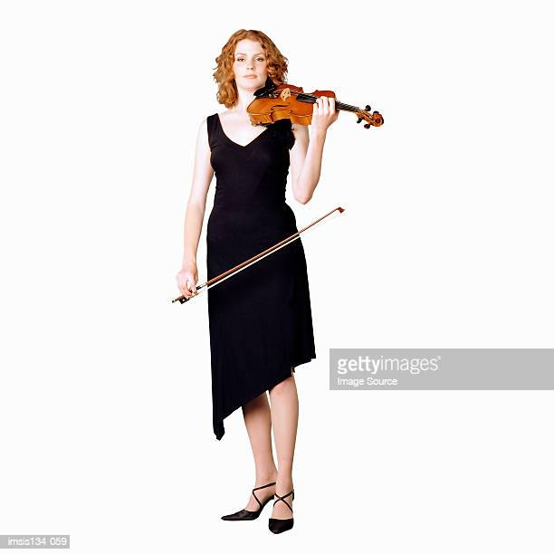 female violinist - musician stock pictures, royalty-free photos & images