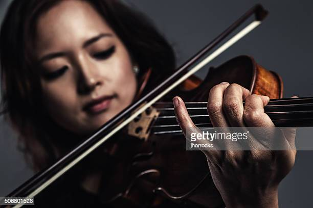 Female Violinist Playing Violin