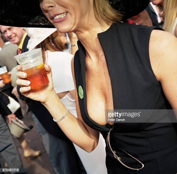A female visitor with a drink at Royal Ascot June 2002