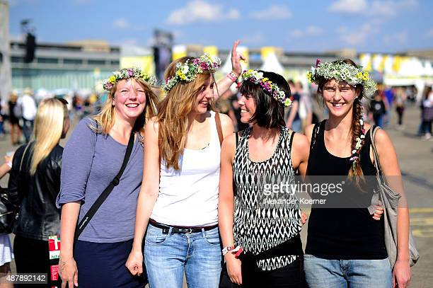 Female visitors pose during the first day of the Lollapalooza Berlin music festival at Tempelhof Airport on September 12 2015 in Berlin Germany