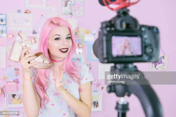female vlogger making social media video about fashion shoes for the internet - influencer stock pictures, royalty-free photos & images