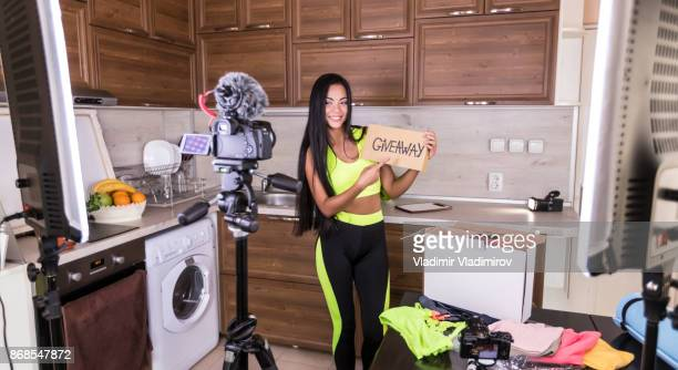 Female vlogger making video at home