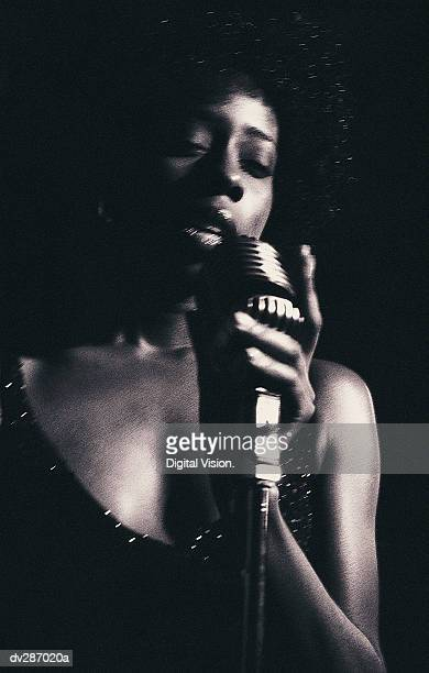 Female vocalist singing into microphone