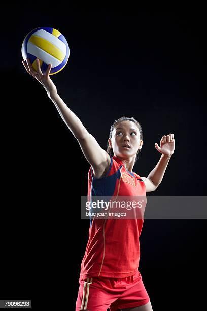 a female volleyball player preparing to serve. - damen volleyball stock-fotos und bilder