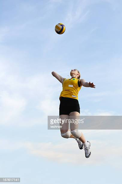 Female volleyball player serving