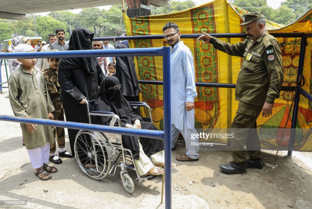 A female voter in a wheelchair approaches a polling station in Lahore Pakistan on Wednesday July 25 2018 Pakistanis are voting today in a closely...