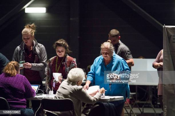 RICHMOND KENTUCKY USA NOVEMBER 6 2018 Female voters receive their ballots at the Eastern Kentucky University's Center for the Arts in Richmond Ky on...
