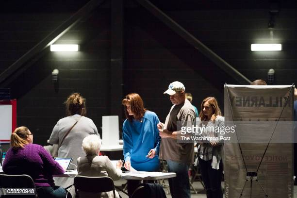 RICHMOND KENTUCKY USA NOVEMBER 6 2018 A female voters receives her ballot at the Eastern Kentucky University's Center for the Arts in Richmond Ky on...