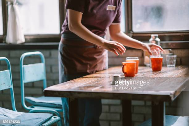 female waitress in restaurant - waitress stock pictures, royalty-free photos & images