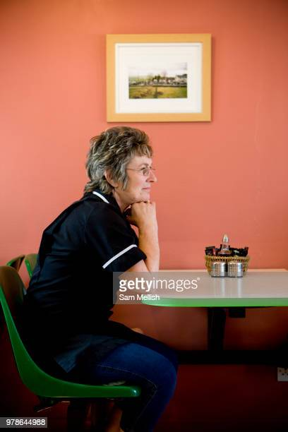 A female waitress sitting at a table at the TyTan cafe along the A5 road on the 20th April 2011 in Cerrigydrudion in the United Kingdom