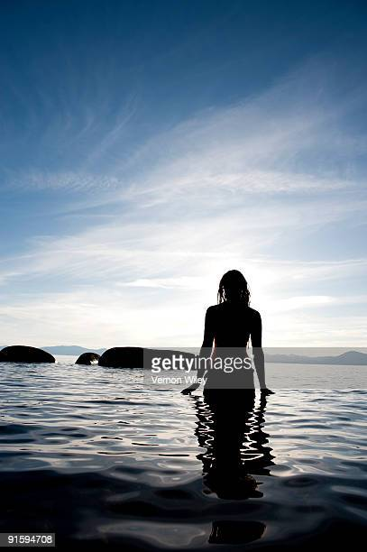 female walking in lake  - waist deep in water stock pictures, royalty-free photos & images