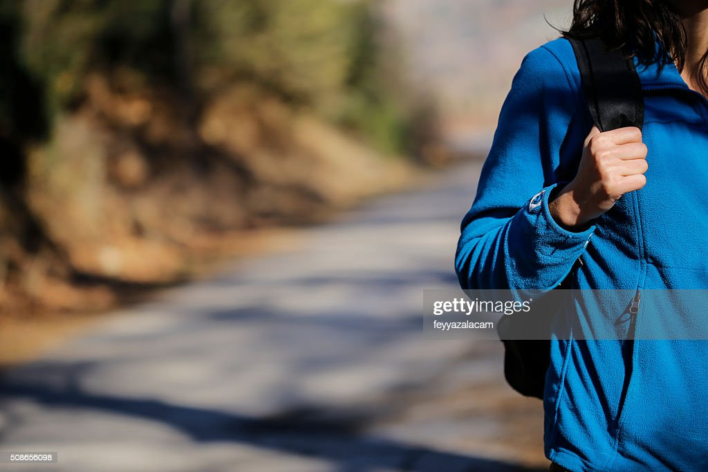 Female walking through the forest : Stock Photo
