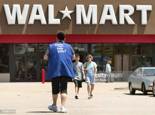 A female WalMart employee walks through a parking lot as she returns to work at a WalMart store June 23 2004 in St Charles Illinois A federal judge...