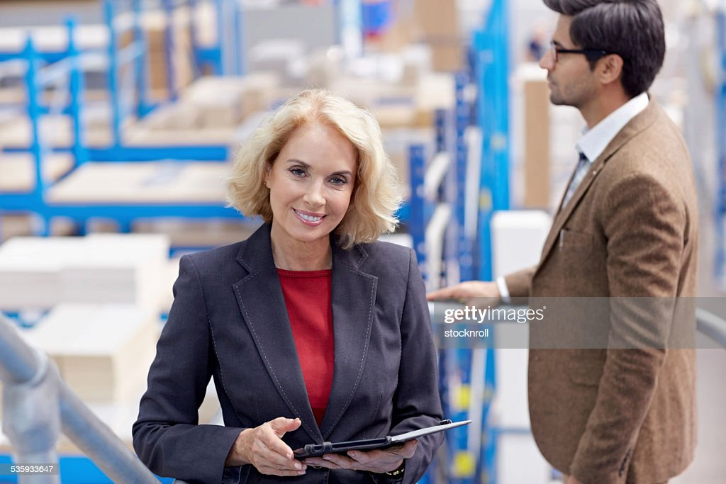 Female warehouse manager with a digital tablet : Stock Photo