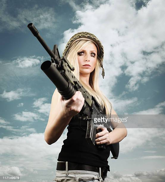 female warrior - machine gun stock pictures, royalty-free photos & images