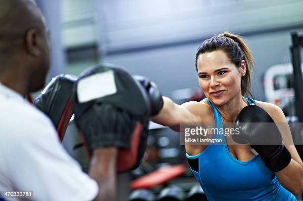 Female Wearing Boxing Gloves, Sparring in Gym