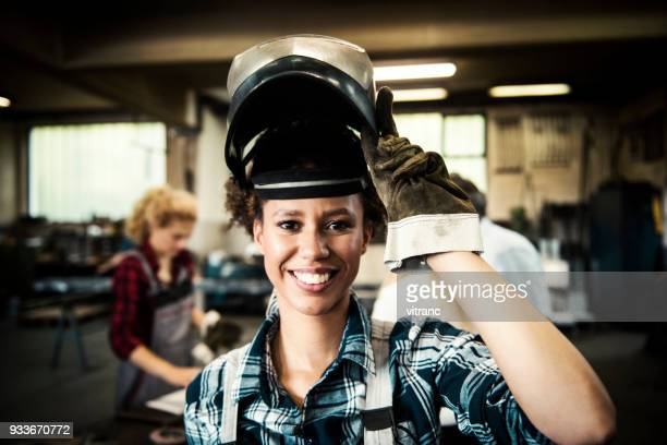 female welder in a metal shop - welding stock photos and pictures