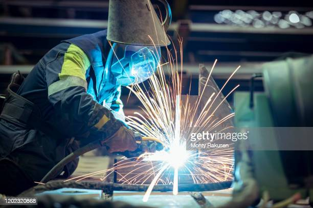 female welder in steelworks - metal industry stock pictures, royalty-free photos & images