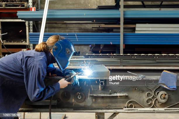 female welder - manufacturing stock pictures, royalty-free photos & images