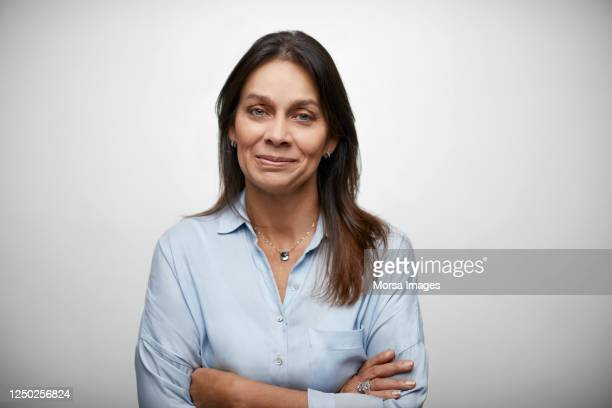 female white collar worker with arms crossed - spanish and portuguese ethnicity stock pictures, royalty-free photos & images