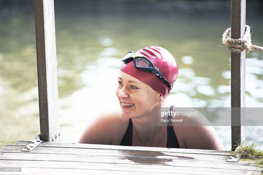 Female wild swimmer in a river : Stock Photo