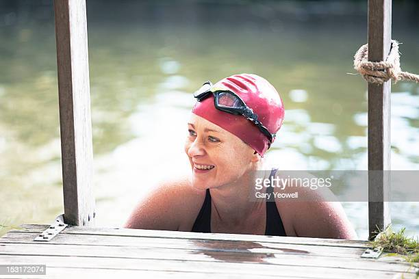 Female wild swimmer in a river