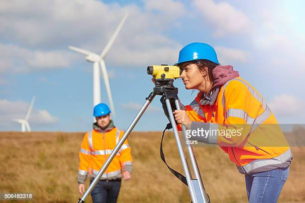 female windfarm engineer - survey stock photos and pictures