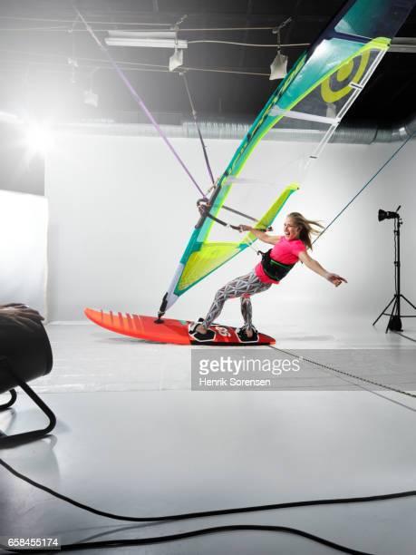 Female windsurfer in a studio