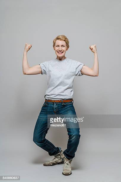 Female winner standing in front of grey background