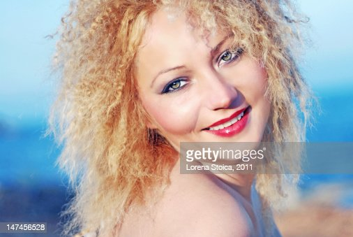 Female With Blonde Hair Blue Green Eyes High Res Stock