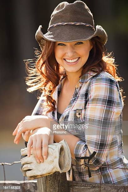 Female With Cowboy Hat Holding Protective Gloves