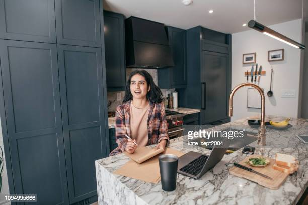 female  with digital tablet and cellphone at home - interior designer stock pictures, royalty-free photos & images